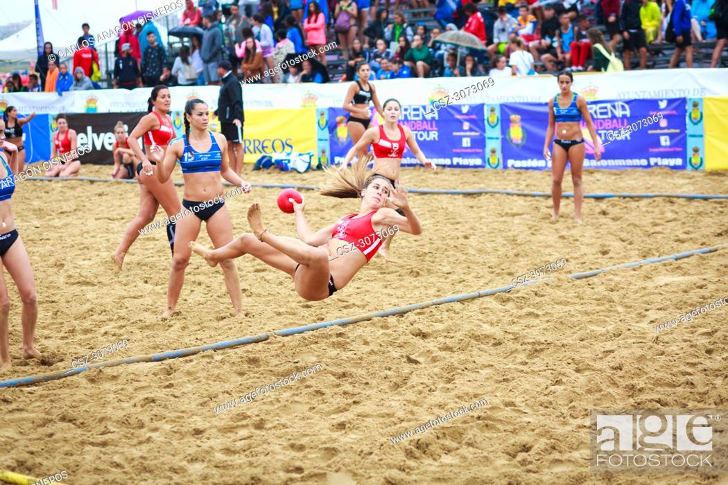 Stock Photo: Unidentified girl, Deporte y Empresa Clinicas Rincon, player launches to goal in the Spain handball Championship celebrated in the beach of Laredo in July 31.