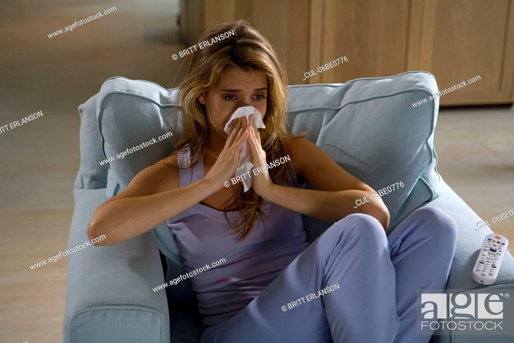 Stock Photo: Woman watching tv, crying.
