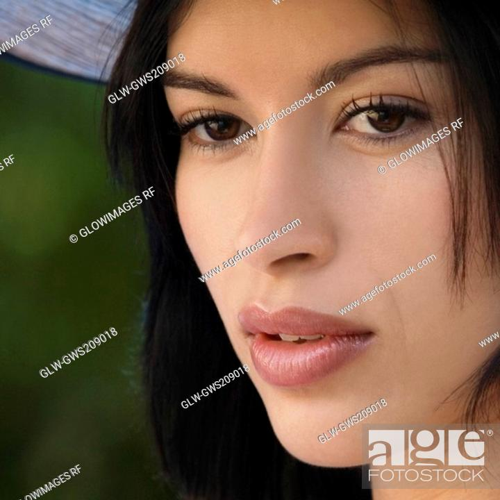 Stock Photo: Close-up of a young woman thinking.