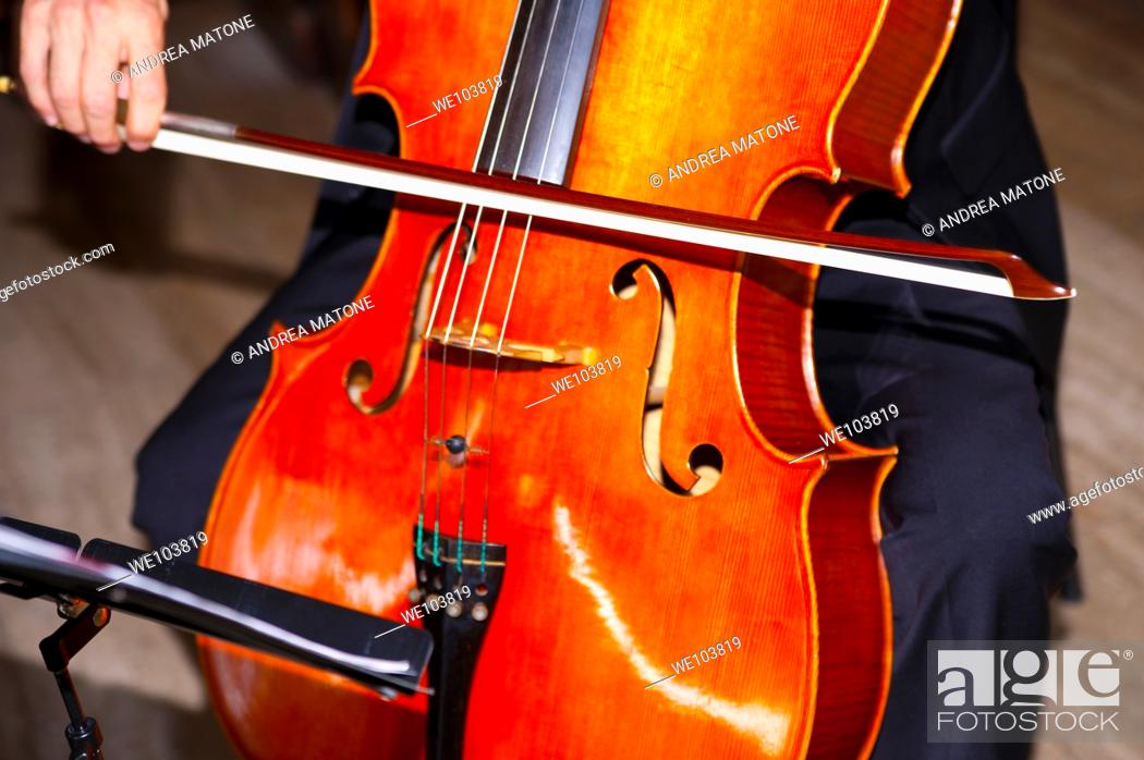 Stock Photo: A cello being played.