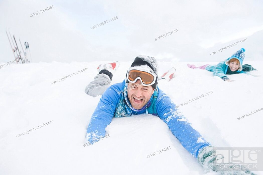 Stock Photo: Italy, South Tyrol, Seiseralm, Couple playing in snow.