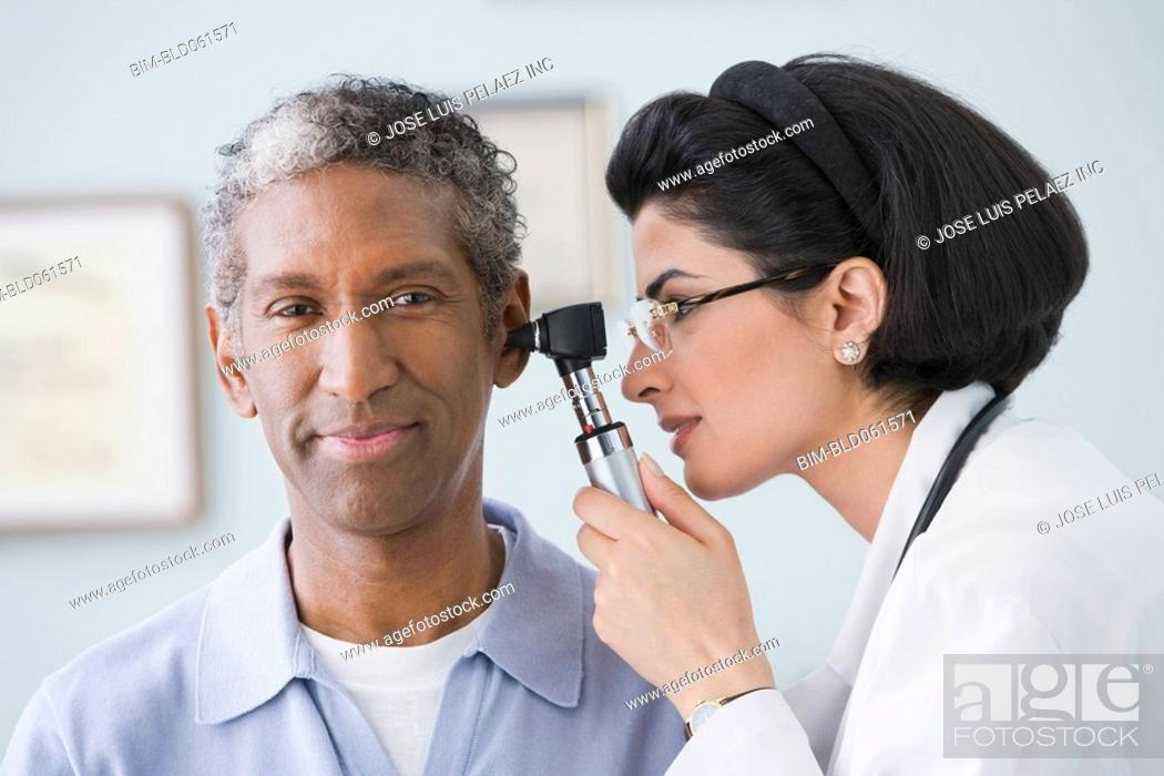 Stock Photo: Middle Eastern female doctor examining patient.