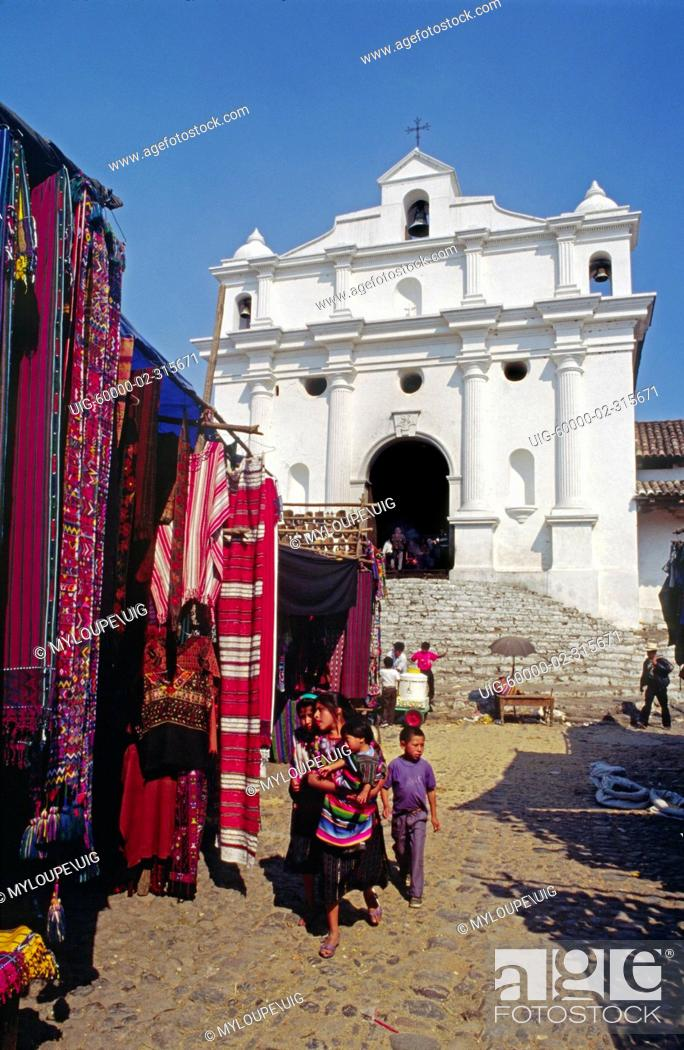 Stock Photo: STREET MARKET selling traditional TEXTILES in front of SANTO TOMAS CHURCH - CHICHICASTENANGO, GUATEMALA.