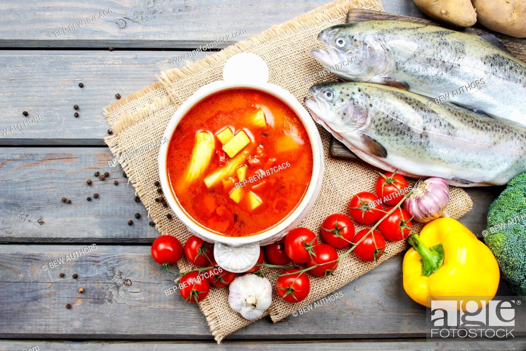Stock Photo: Bowl of tomato soup on wooden table.