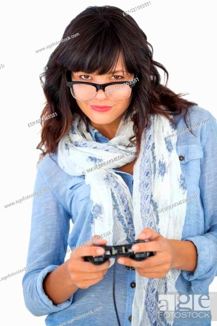 Stock Photo: Beautiful woman wearing scarf and glasses playing video games.