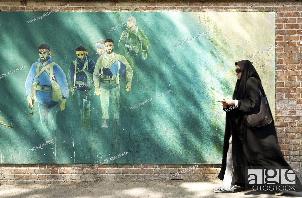 Stock Photo: veiled woman in teheran iran street.