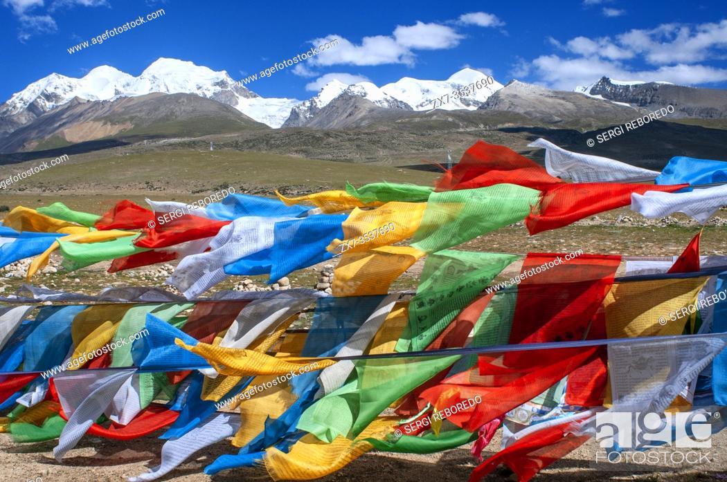 Stock Photo: La Ken La pass or Laken pass at 5190 metres on the road to remote Nam Tso Lake Tibet. Namtso Lake Tibet China. Prayer flags next to the base of Mount Nyenchen.