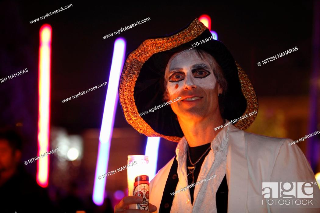 Stock Photo: Dia de los Muertos is a Meso-American tradition dedicated to the ancestors which honors both death and the cycle of life  The celebration acknowledges that we.