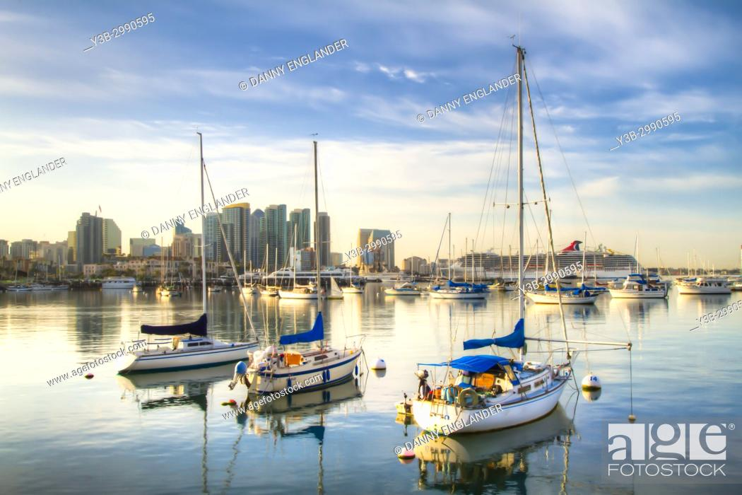 Stock Photo: Three sail boats with a glassy reflection on San Diego Bay at sunrise.