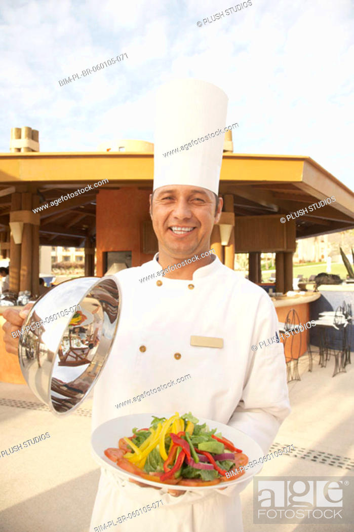 Stock Photo: Hispanic male chef with plate of vegetables, Los Cabos, Mexico.