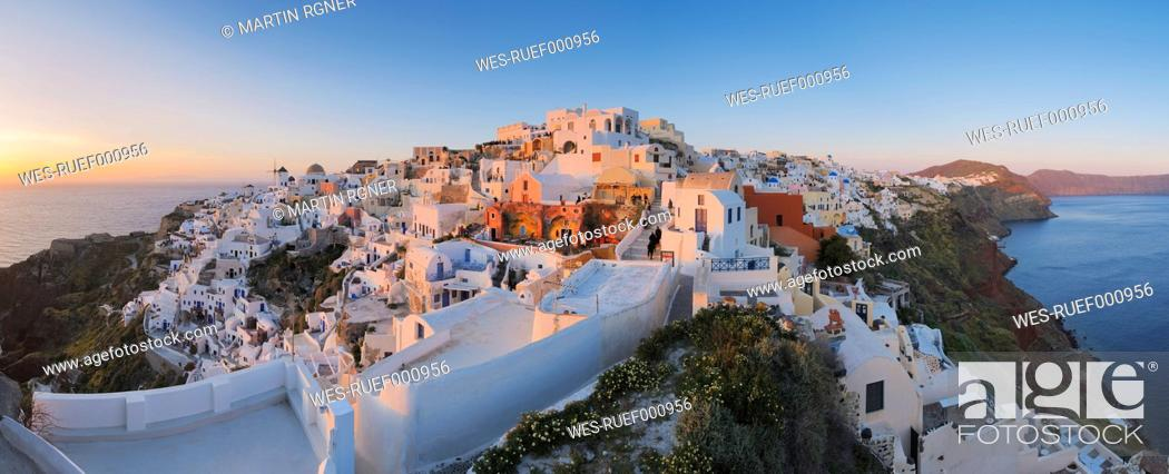 Stock Photo: Greece, View of Oia village in sunset at Santorini.