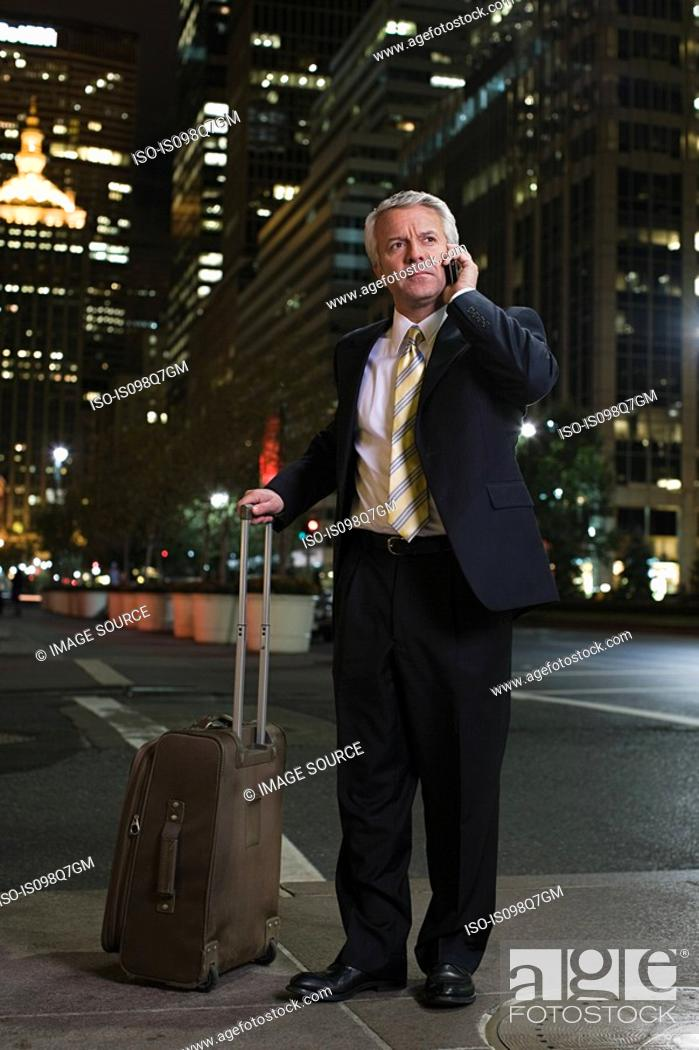 Stock Photo: Businessman with a suitcase.
