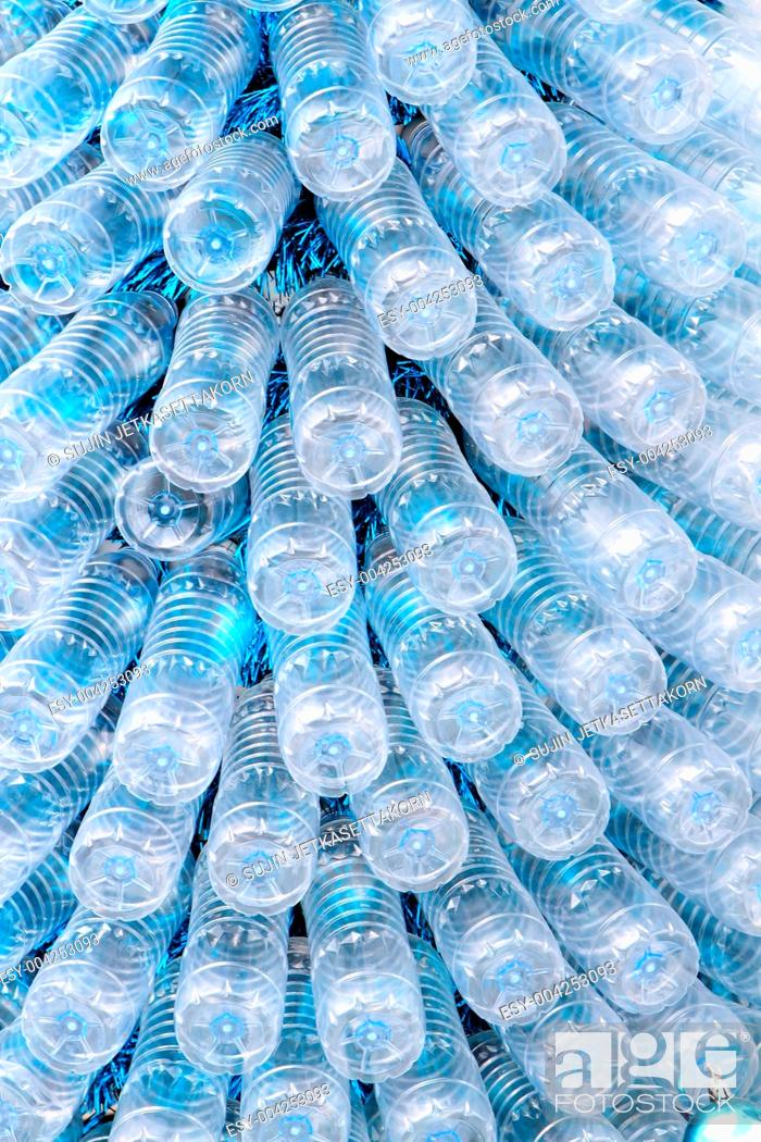 Stock Photo: rows of empty plastic bottles at bottling plant.