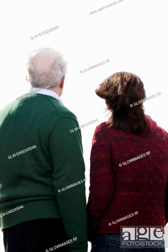 Stock Photo: Rear view of a couple standing together.