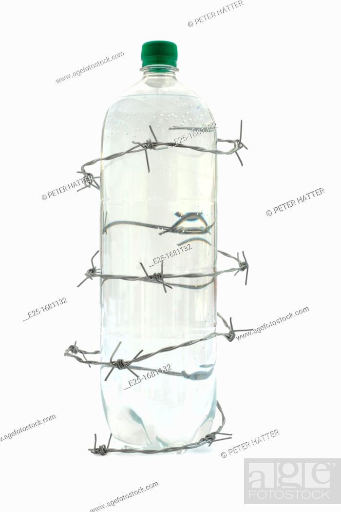 Stock Photo: Bottled water surrounded by barbed wire.