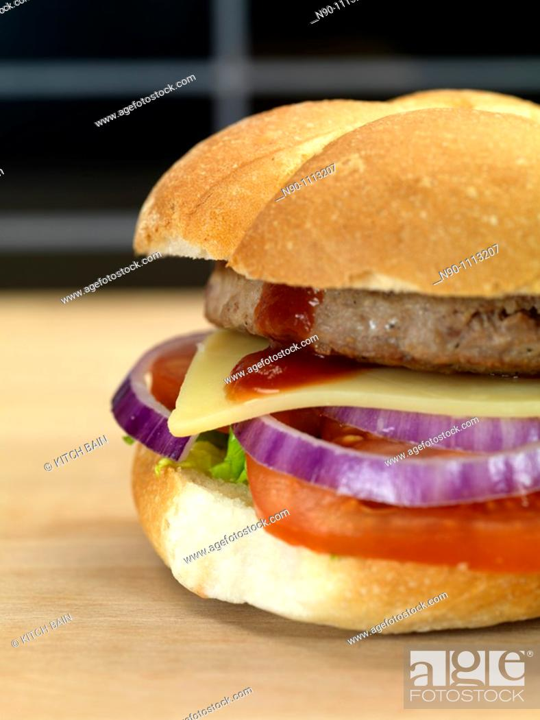 Stock Photo: A freshly made American style hamburger with sauce.