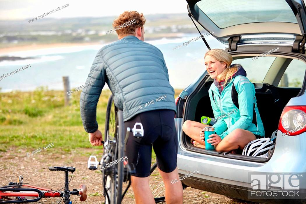 Stock Photo: Cyclists preparing bicycle for ride.