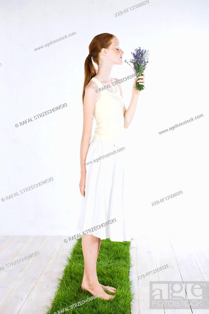 Stock Photo: young woman with lavender.