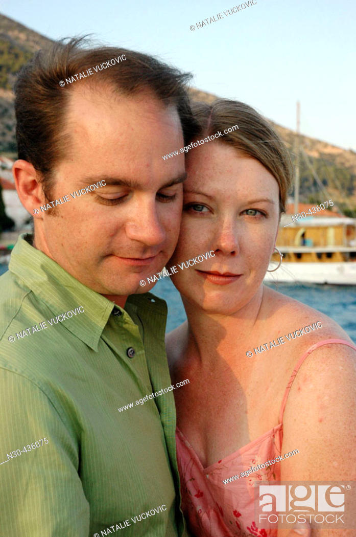 Stock Photo: Young Couple with Ocean as background.