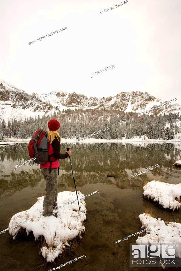 Stock Photo: Hiker enjoying the view of Sawtooth montains with the reflection in Phyllis lake, Idaho.