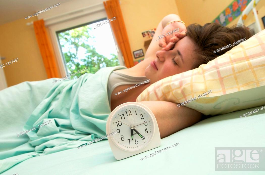 Stock Photo: Young woman awaking in her bed.