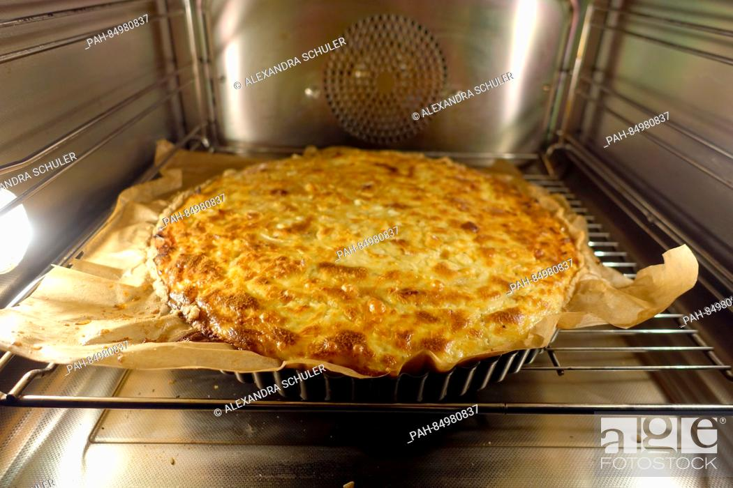 Stock Photo: An onion cake is placed into the oven in Oberkirch, Germany, 13 October 2016. The savoury cake is mostly eaten in southern Germany, in Switzerland and in Alsace.
