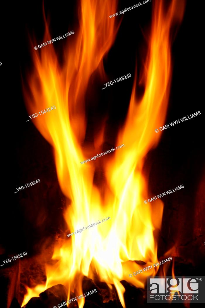 Stock Photo: coal fire in living room.