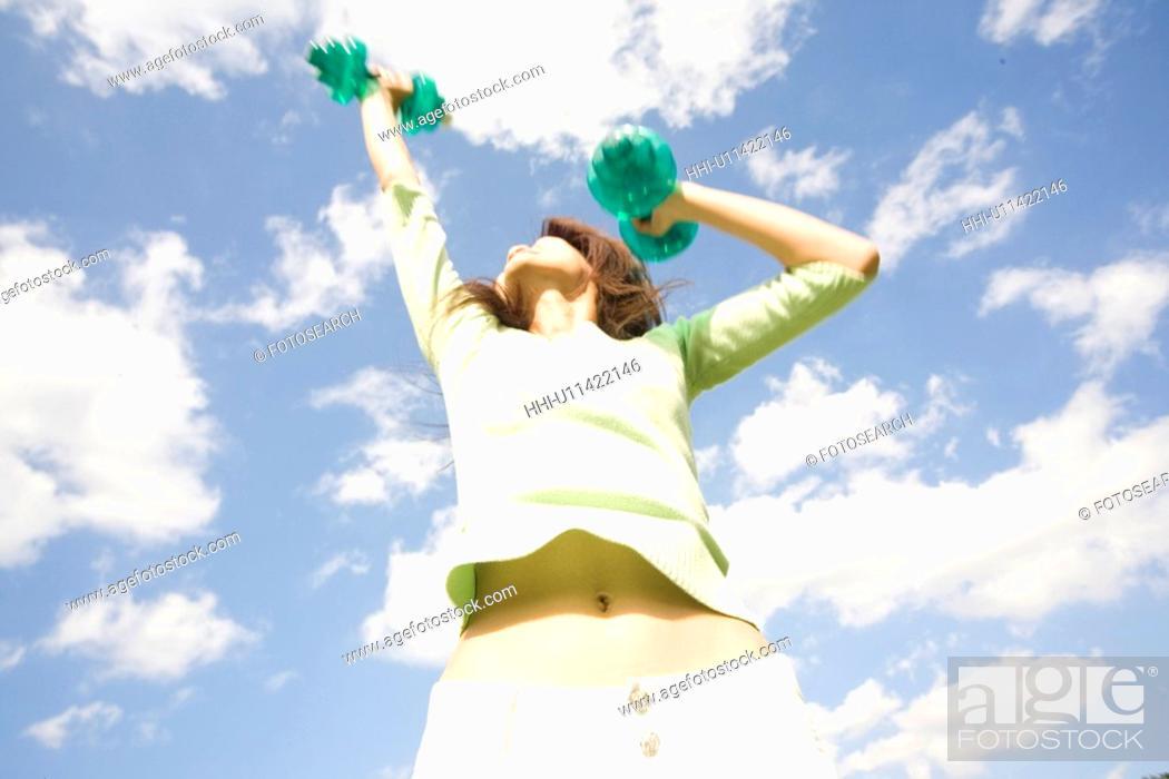 Stock Photo: Womandoing exercise.