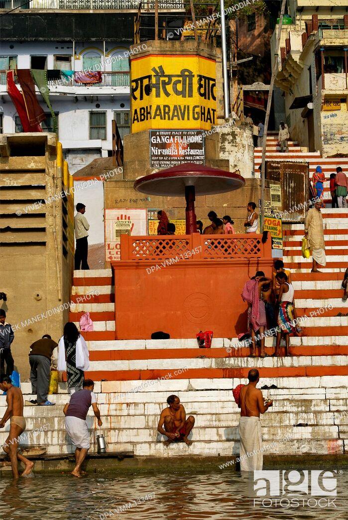 Stock Photo: People bathing in holy Ganga river at Rabharavi ghat ; Varanasi ; Uttar Pradesh ; India.
