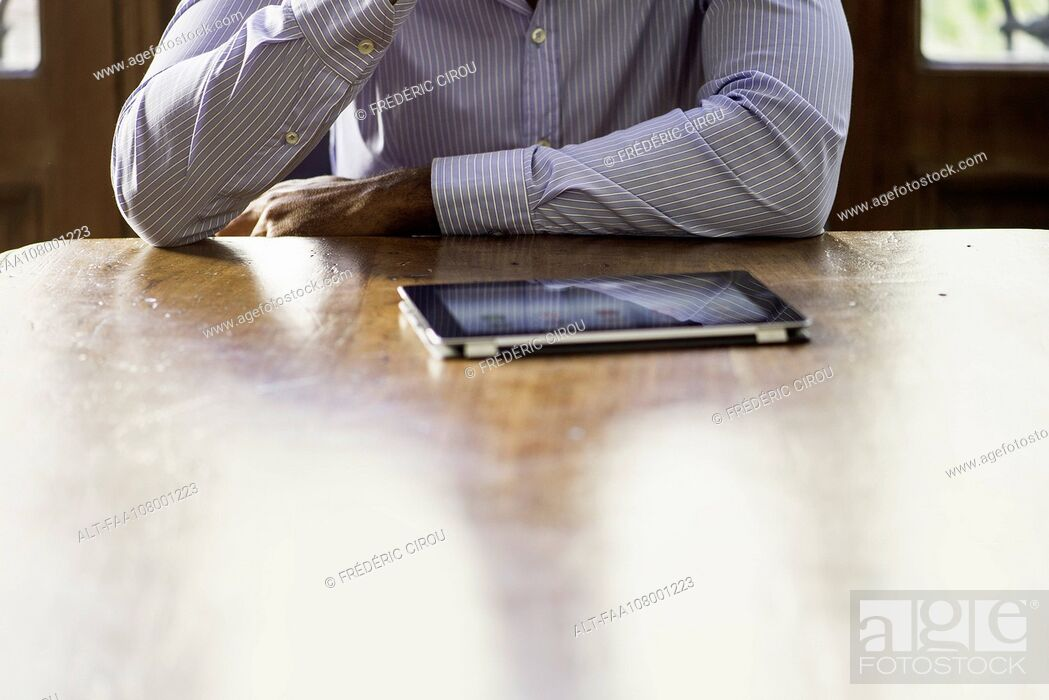 Stock Photo: Businessman using digital tablet for video conference.