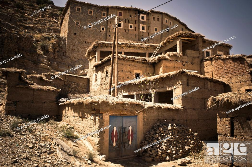 Stock Photo: Berber village of adobe houses in the High Atlas, Azilal, Morocco.