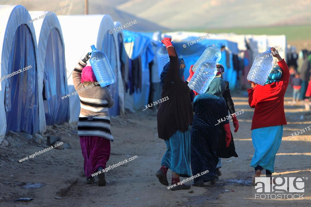 Stock Photo: Refugees fetching water in a refugee camp in Northern Iraq.