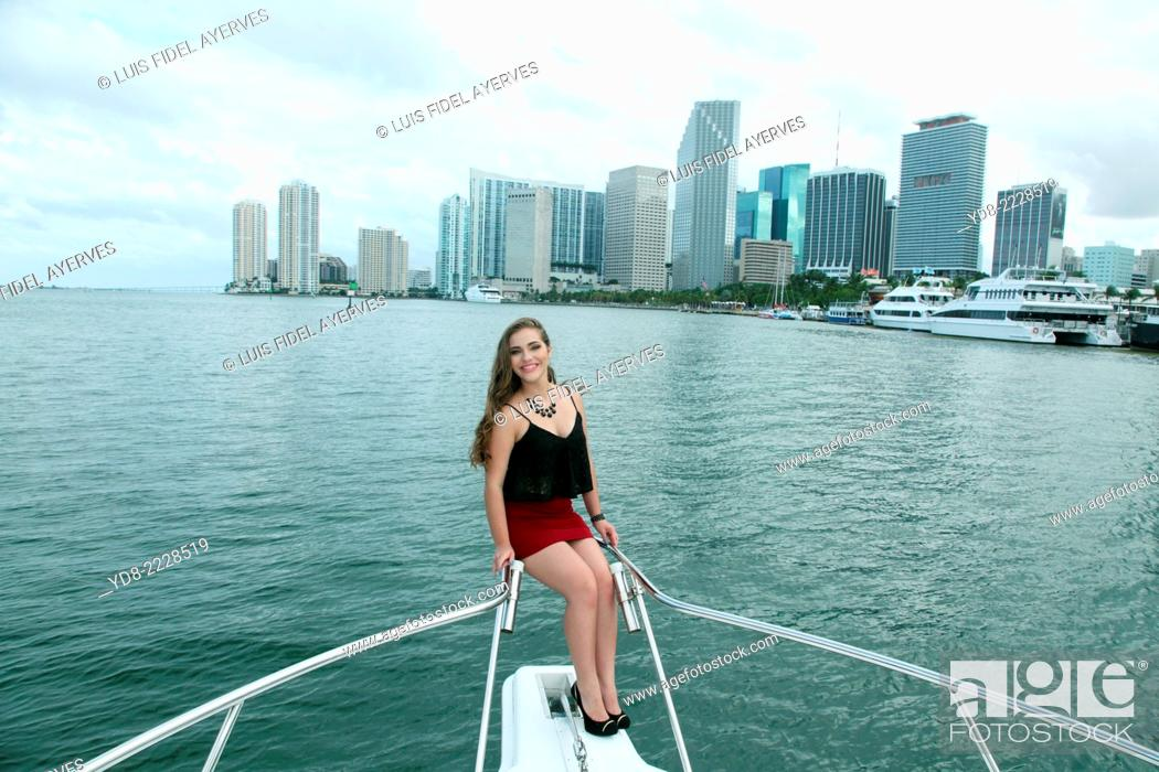 Stock Photo: Quinceañera Young posing on the bow of a yacht off the coast of Miami, Florida, USA.