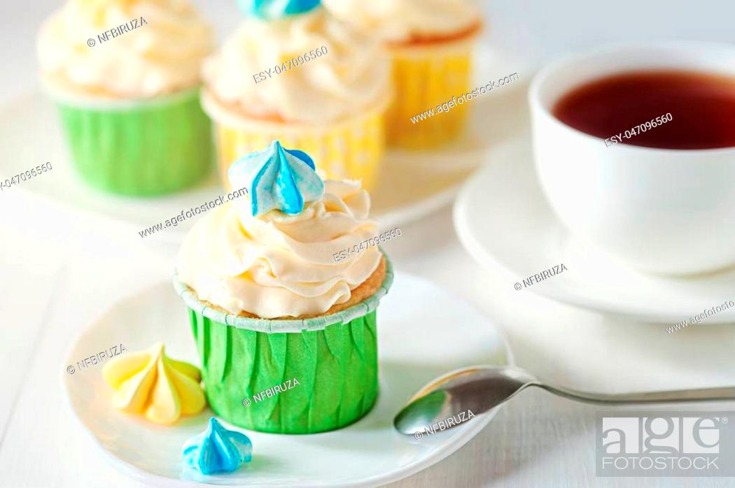 Stock Photo: A sunny morning ladies breakfast tea with home cupcake with meringues. Good morning concept.