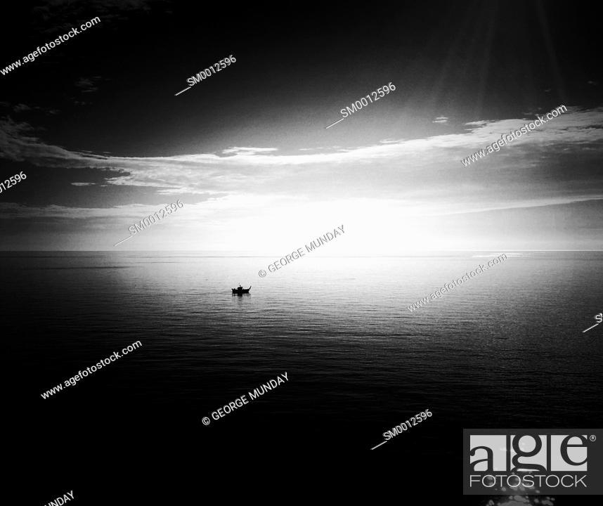 Stock Photo: A lone fishing boat in the Mediterranean Sea off Nerja, . Costa del Sol, Malaga Province,. Andalucia, Spain. .