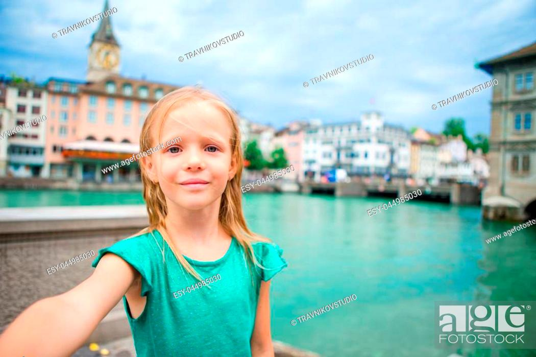 Stock Photo: Adorable little girl taking selfie with mobile phone outdoors in Paris, France.