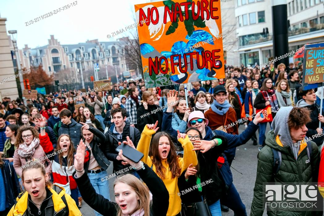 Stock Photo: BRUSSELS, Feb. 28, 2019 Students hold placards as they attend a climate march in Brussels, Belgium, on Feb. 28, 2019. A new climate march by schoolchildren and.