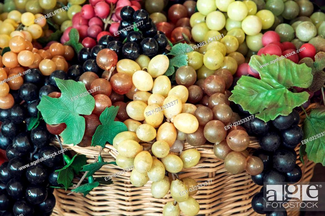 Stock Photo: Mix of various grapes in wicker baskets.