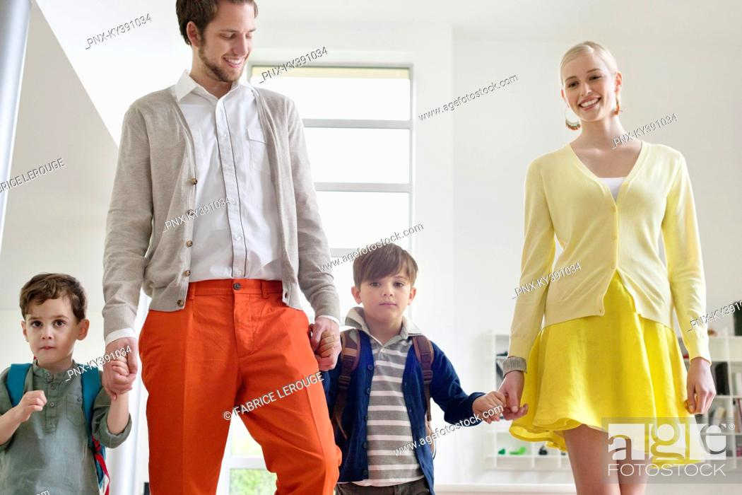 Stock Photo: Couple walking with their children.