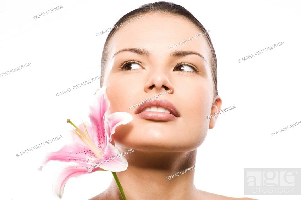 Stock Photo: portrait of beautiful woman with lily.