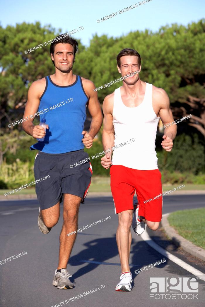 Stock Photo: Two Men Running On Road.
