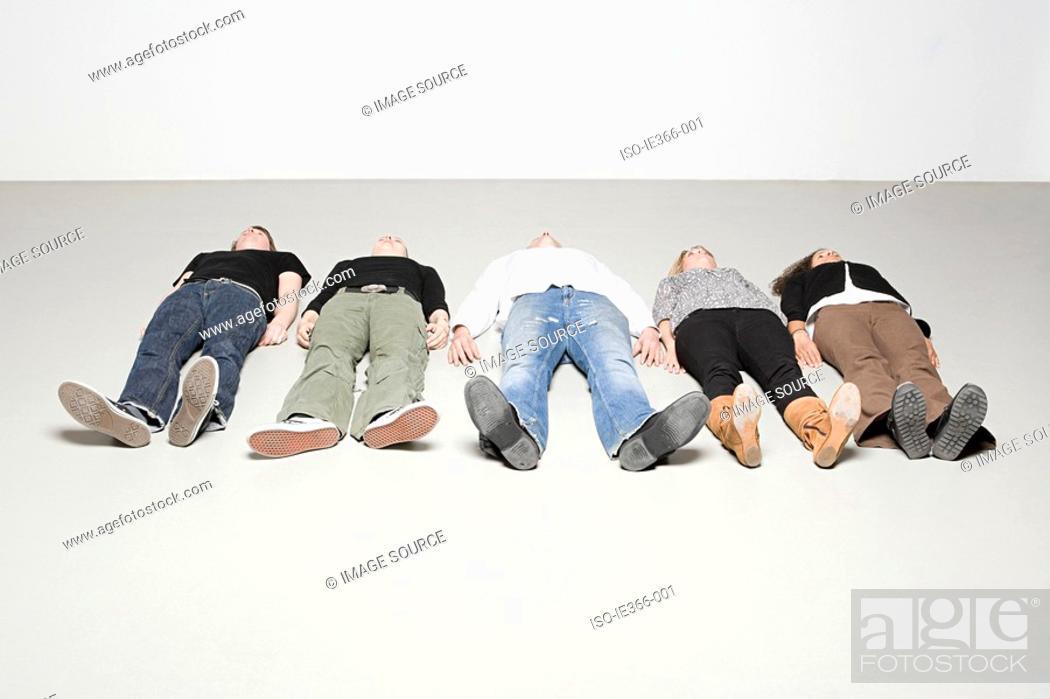 Stock Photo: People lying down.