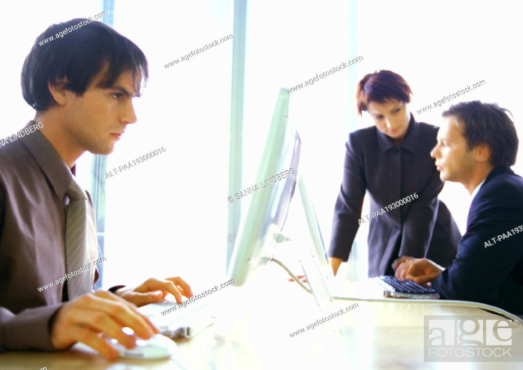 Stock Photo: Business people working.