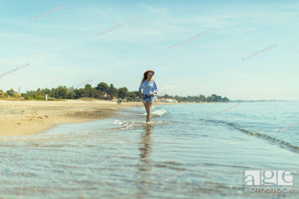 Stock Photo: Woman walking at seaside.