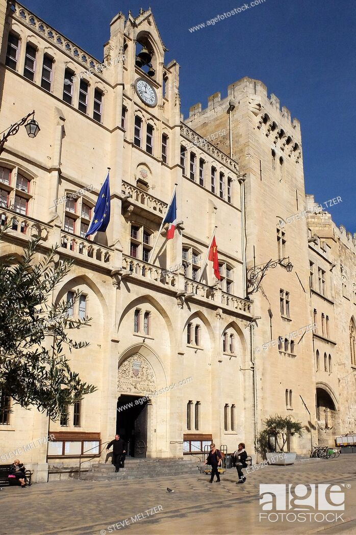 Stock Photo: The Historic heart of the city of Narbonne, France in front of the Hotel de Ville. The facade was constructed between 1846-1852 in the Troubador style.