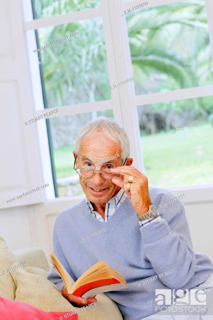 Stock Photo: Senior man reading book.