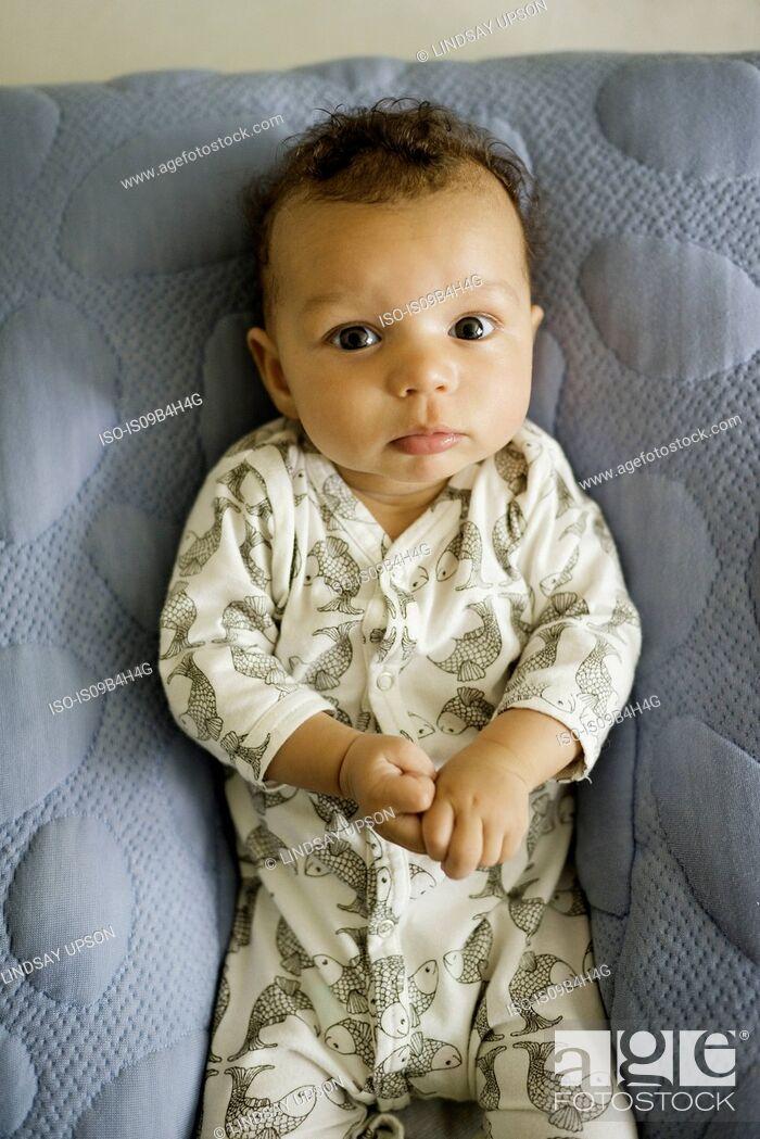 Stock Photo: Portrait of baby boy lying on blanket, overhead view.