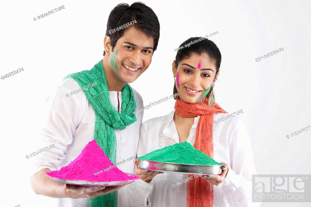 Stock Photo: Couple holding a tray of colours.