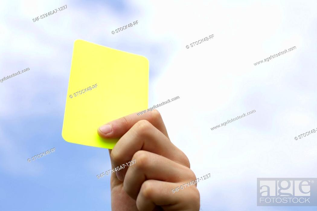 Stock Photo: Referee showing yellow card.
