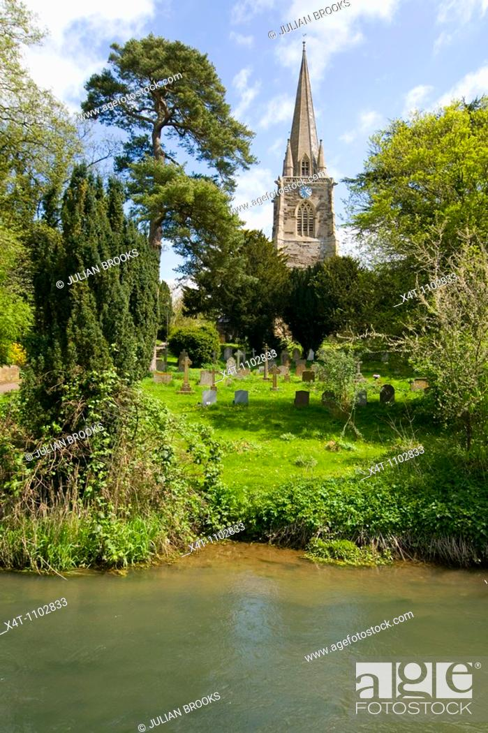 Stock Photo: The church at West Adderbury in the Cotswolds, Oxfordshire, UK, looking across the river Glyme.